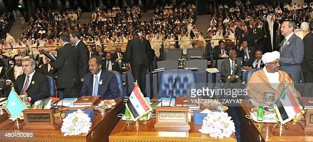 Iraqi vice President Khudhair alKhazaee Somalian President Hasan Sheikh Mahmoud and Sudani President Omar alBasheer sits next to the empty Syrian...