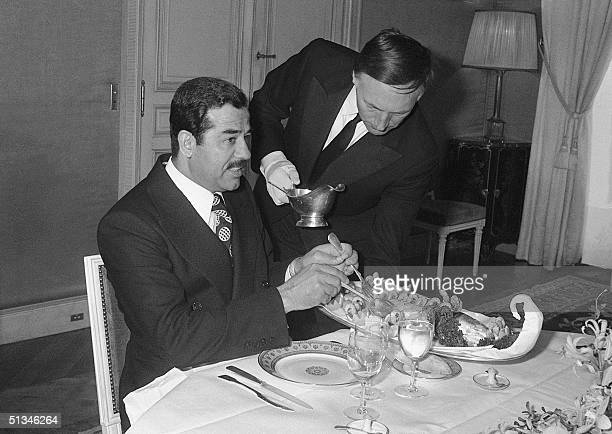 Iraqi VicePresident Saddam Hussein has a lunch 03 March 1975 in Hotel Matignon in Paris during his meeting with French Prime minister Jacques Chirac...