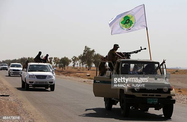 Iraqi volunteer fighters advance towards the Shiite town of Amerli from their position in the Ajana area, ten kilometres south of the town, in...