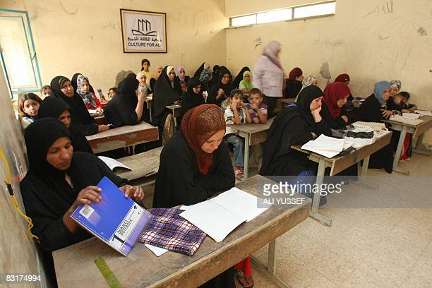 Iraqi women and girls attend a literacy class at a school in the Hay alAmel neighborhood of Baghdad on September 9 2008 The classes under the...