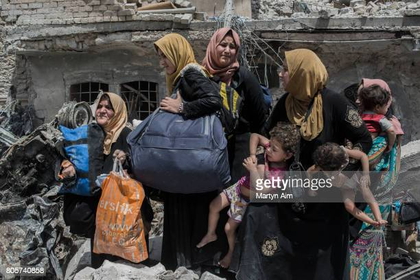 Iraqi women and their children flee the Old City district where heavy fighting continues on July 2 2017 in Mosul Iraq Iraqi forces continue to...