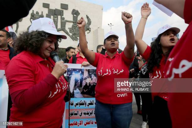 Iraqi women celebrate World Women's Day in Tahrir Square in central Baghdad on March 8 2019