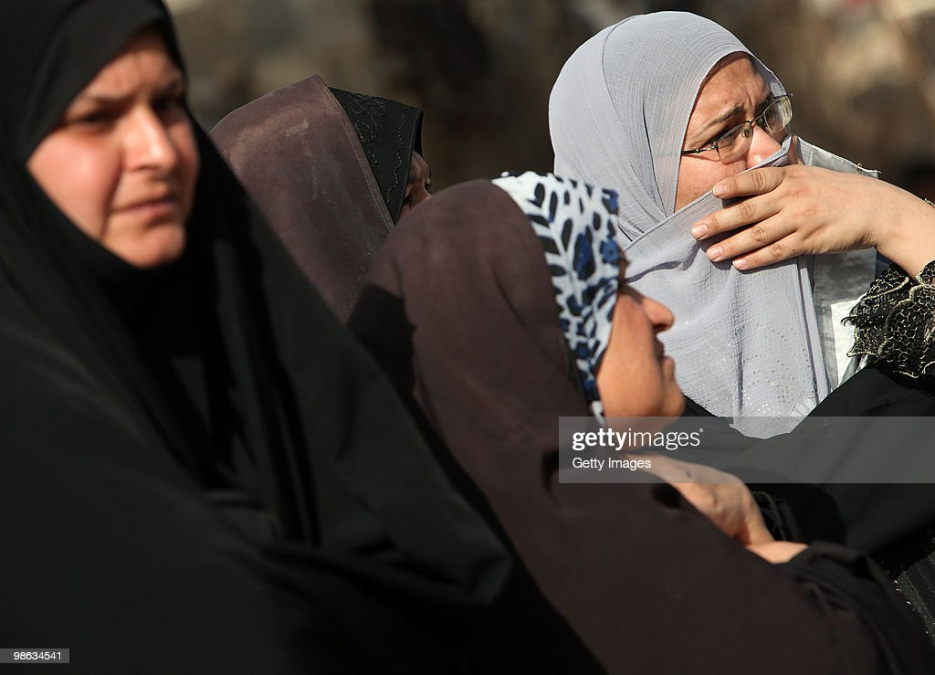 Iraqi women cry near Mohsin al-Hakim Shiite mosque, which was the scene of a bombing on April 23, 2010 in Baghdad, Iraq. A series of bombings rocked a market and Shiite mosques as worshippers departed Friday Prayer services, killing at least 60 people and wounding many more.