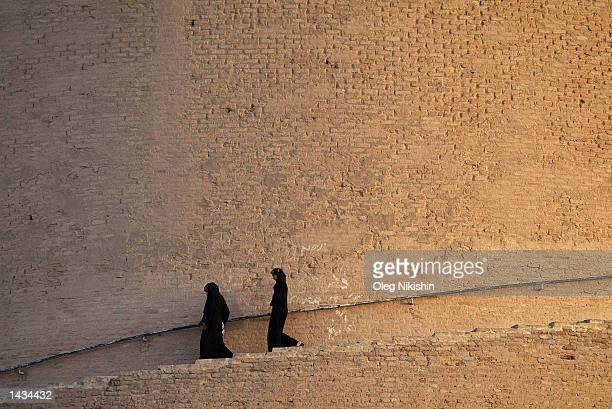 Iraqi women descend from the XIX century spiral minaret September 25 2002 in the town of Samara 50 miles north of Bahgdad As the administration of US...