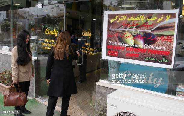 Iraqi women enter the popular Cindy restaurant in the northern Iraqi Kurdish city of Sulaimaniyah which has a poster in the window announcing that...