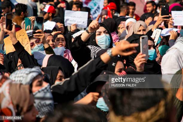 Iraqi women gesture as they take part in an antigovernment demonstration in the southern city of Basra on February 6 after a night of violence blamed...