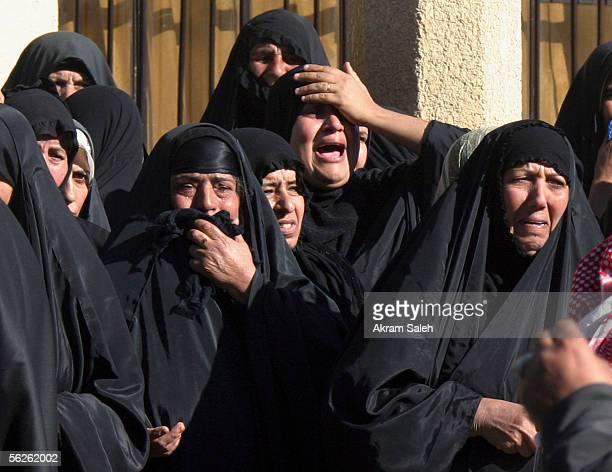 Iraqi women grieve during the funeral of Sunni Arab tribal leader Khadim Sarhid alHemaiyem on November 23 2005 in Baghdad Iraq AlHemaiyem was killed...