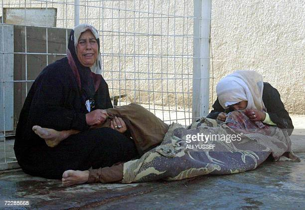 Iraqi women grieve over the body of a relative after he was shot by unknown gunmen in a local market at the local Baquba hospital morgue 60 kms...