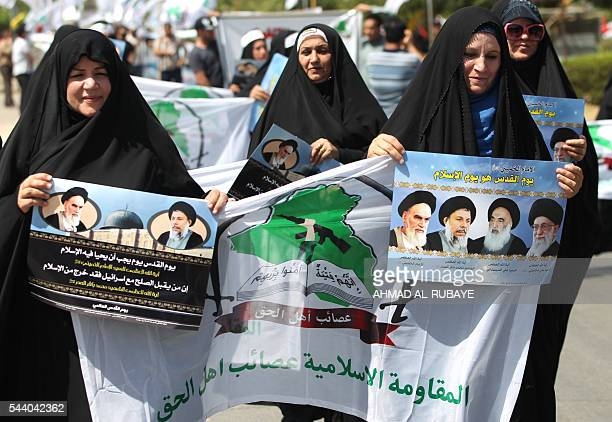 Iraqi women hold placards depicting portraits of Iran's supreme leader Ayatollah Ali Khamenei Grand Ayatollah Ali Sistani former Iraqi Shiite cleric...