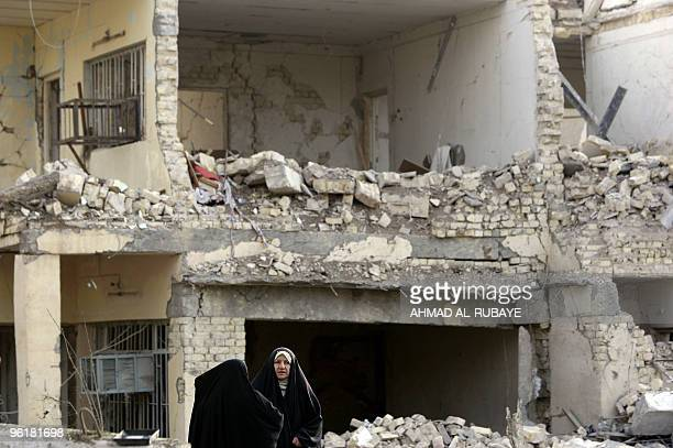 Iraqi women inspect damages a day after a bomb blast near the Hamra Hotel in Jadriyah south of Baghdad on January 26 2010 Three huge and apparently...