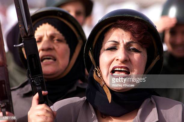 Iraqi women march among thousands of volunteers in defiance of US threats to invade Iraq February 4 2003 in the city of Mosul 450 kilometers north of...