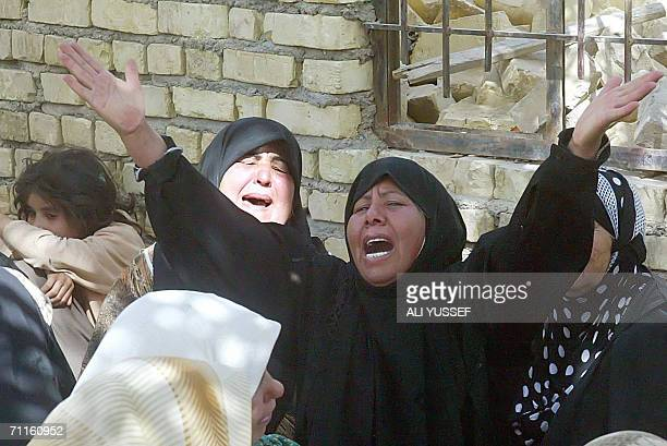 Iraqi women mourn the death of their relatives who were killed in the restive city of Baquba northeast of Baghdad 09 June 2006 Four people were...