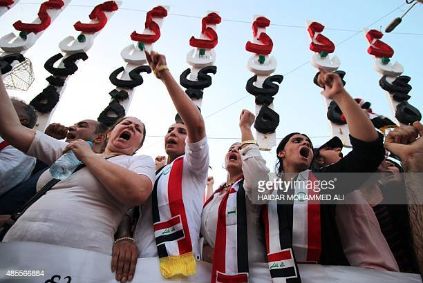 Iraqi women protesters shout slogans during a demonstration against corruption in Baghdad's Tahrir Square on August 28 2015 Protesters have taken to...