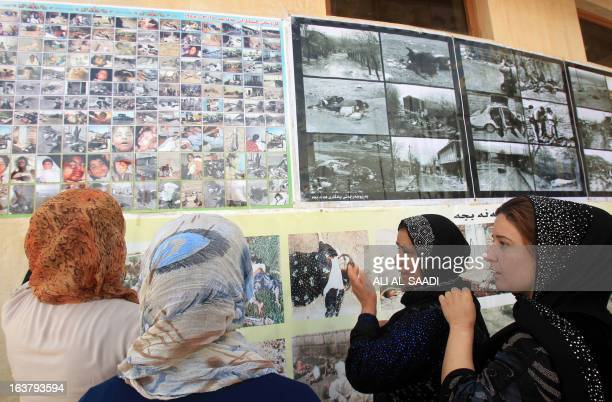 Iraqi women react as they look at pictures of victims of a gas attack by former Iraqi president Saddam Hussein in 1988, at the memorial site of the...