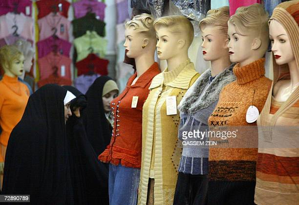 Iraqi women shop for clothes two days before the onset of Eid AlAdha the Feast of Sacrifice 28 December 2006 in Najaf Iraq was braced for the...