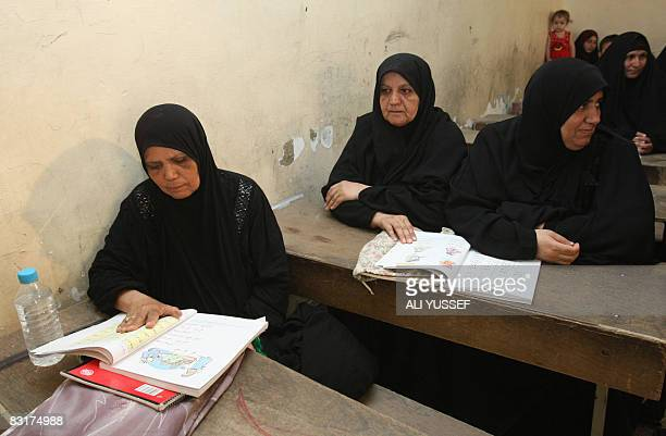 Iraqi women take part in a literacy class at a school in the Hay alAmel neighborhood of Baghdad on September 9 2008 The classes under the umbrella...