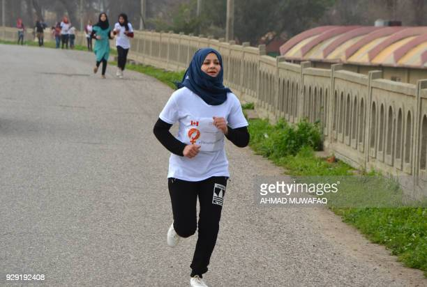 Iraqi women take part in a symbolic 900metres marathon to mark Women's Day in the former embattled city of Mosul on March 8 2018 eight months after...