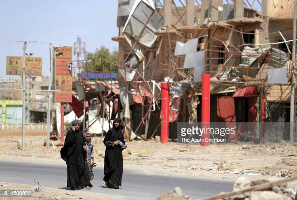 Iraqi women walk on the street on July 11 2017 in Mosul Iraq Iraqi Prime Minister Haider alAbadi declared the victory over the Islamic States in...