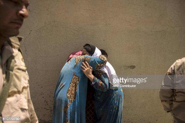 TOPSHOT Iraqi women who fled the fighting between government forces and Islamic State group jihadists in the Old City of Mosul cry as they stand in...