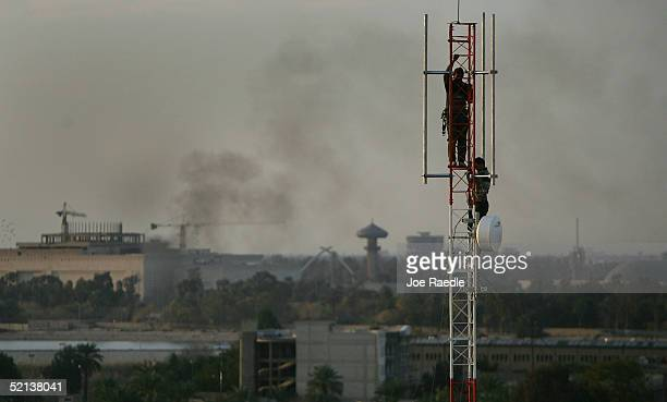 Iraqi workers construct a cell phone tower February 5 2005 in Baghdad Iraq As the country continues to wait for the results on their election an...