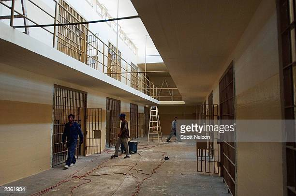 Iraqi workers help renovate the former Abu Ghraib prison August 4, 2003 in Baghdad, Iraq. Which is being cleaned and renovated by the 94th Engineer...