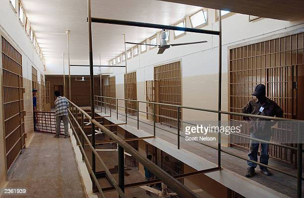Iraqi workers move bunks into a section of the former Abu Ghraib prison prison August 4 2003 in Baghdad Iraq Which is being cleaned and renovated by...