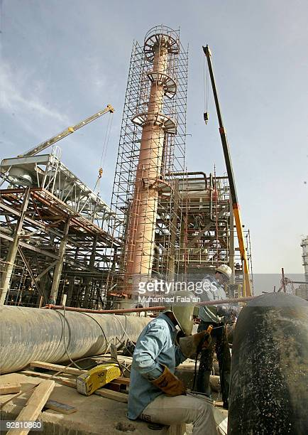 Iraqi workers weld a pipe at the Daura oil refinery on November 5 2009 in Baghdad Iraq Iraq and a grouping of US and European oil companies Exxon...