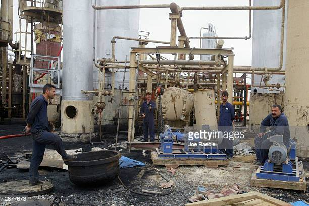 Iraqi workers work on repairing the Kissik oil refinary October 29 2003 in Ninewa Province Iraq The refinary is running at 60 percent of capacity...