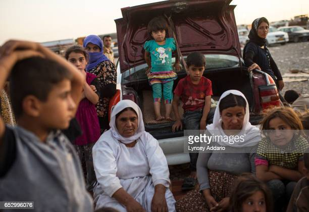 Iraqi Yazidi families camp out in the Bahjad Kandal camp near the Iraqi border with Syria in Northern Iraq August 16 2014 Since IS started making its...
