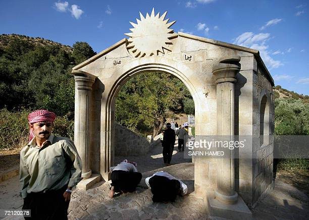 Iraqi Yazidis kiss the ground as they arrive to Lalish temple situated in a valley near Dahuk, 430 Kilometers northwest of Baghdad, during the...