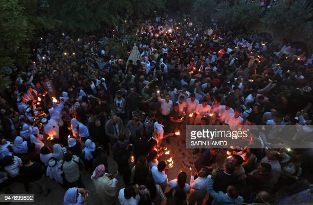 TOPSHOT Iraqi Yazidis light candles and paraffin torches outside Lalish temple situated in a valley near Dohuk 430 km northwest of Baghdad during a...