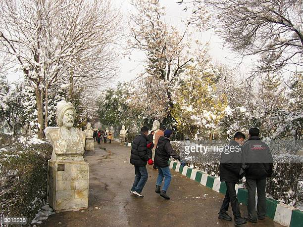 Iraqi young men play at a snowcovered public garden in the Kurdish city of Sulaimaniya 330 kms north of Baghdad 24 February 2004 It snowed in...