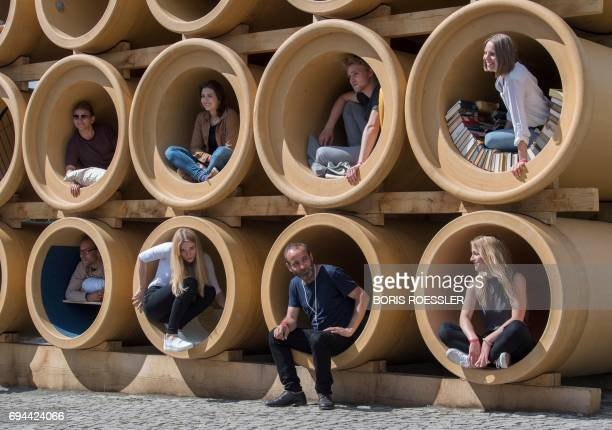 IraqiKurdish artist Hiwa K waits for the official delegation by his installation during the official opening of the documenta 14 in Kassel Central...