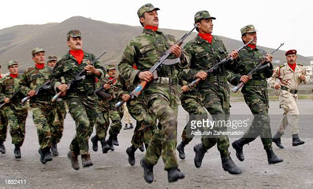 Iraqi-Kurdish soldiers march during military training at the Soran training camp March 16, 2003 west of Erbil, in Northern Iraq. About 1200 Kurdish...