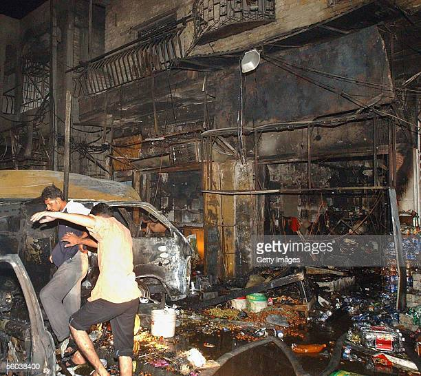 Iraqis are seen at the site of car bomb explosion October 31, 2005 in Basra, Iraq. A car bomb exploded on a commercial street in the southern Iraqi...