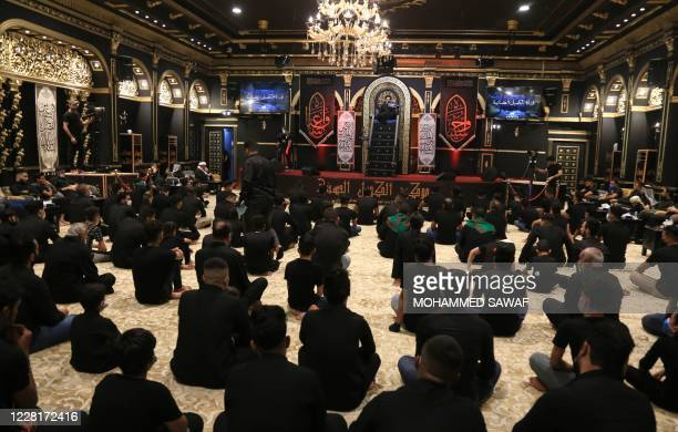 Iraqis attend a mourning ritual as Shiite Muslims commemorate Ashura during the Islamic month of Muharram, in the central shrine city of Karbala, on...