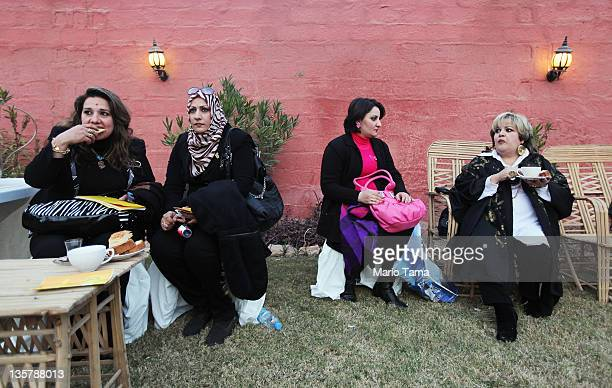 Iraqis attend a women's art exhibition sponsored by Iraqi Parliament member Safi Asiheil in a posh Baghdad neighborhood on December 14 2011 in...