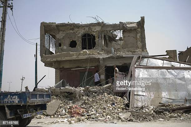 Iraqis begin reconstruction of destroyed buildings after two months of fighting along front line Al Quds Street in Sadr City the 25 million Shia...