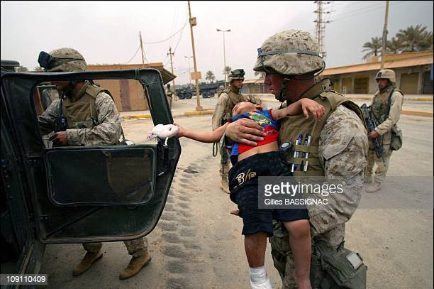 Iraqis Bury Their Dead As Us Marines Of The 3Rd Bat/4Th Reg. Pursue Progression Into Baghdad. On April 8, 2003 In Baghdad, Iraq. April 7 On The...
