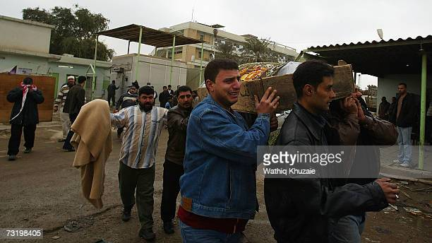 Iraqis carry a coffin of a relative killed in Yesterday's suicide car bomb explosion as funerals for the dead begin on February 4 2007 in Baghdad...