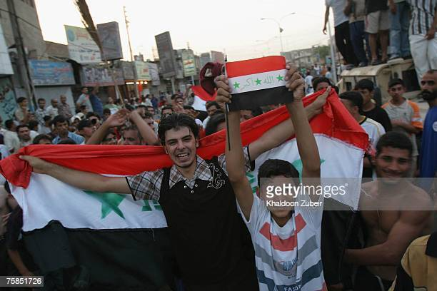 Iraqis celebrate after the Iraqi team won the final game of the 2007 AFC Asian Cup soccer tournament against Saudi Arabia July 29 2007 in Basra Iraq...