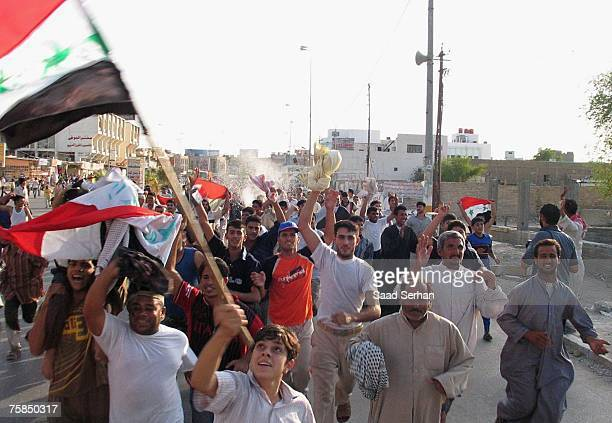 Iraqis celebrate after their national team won the final game of the 2007 AFC Asian Cup soccer tournament against Saudi Arabia on July 29 in the...