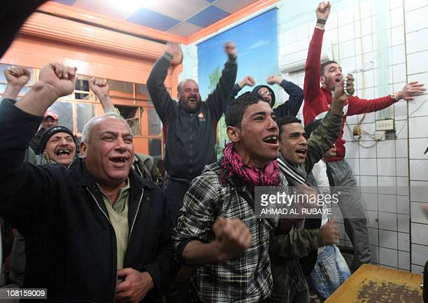 Iraqis celebrate in Baghdad on January 19 the qualification of their team to the quaterfinal of the 2011 Asian Cup in Doha beating North Korea 10...