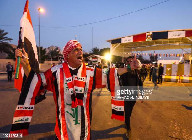 Iraqis celebrate the reopening of the Green Zone home to government buildings and Western embassies on December 10 2018 in the capital Baghdad Iraq's...