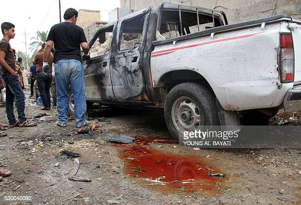 Iraqis check on May 10 2016 the site of a car bomb explosion which hit the Shifta area in the city of Baquba the previous day killing at least 10...