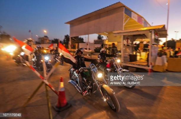 Iraqis cross a checkpoint as they celebrate the reopening of the Green Zone home to government buildings and Western embassies on December 10 2018 in...
