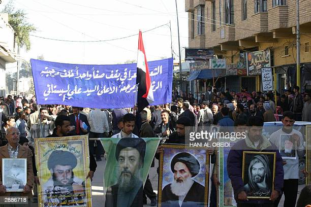 Iraqis demonstrate carrying pictures of most influential Iraqi Shiite figures late Ayatollah Mohammad Sadeq Sadr Sayyed Muqtada Sadr late Ayatollah...