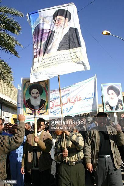 Iraqis demonstrate holding up pictures of Iran's supreme leader Ayatollah Ali Khamenei and Shiite Grand Ayatollah Ali alSistani 21 January 2004 in...