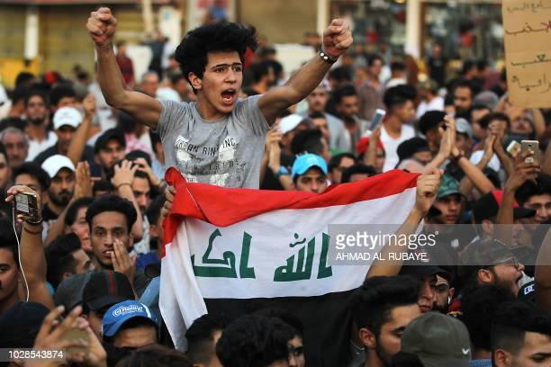 TOPSHOT Iraqis demonstrate in Tahrir Square in central Baghdad on September 7 against corruption and lack of services Three mortar shells hit late...