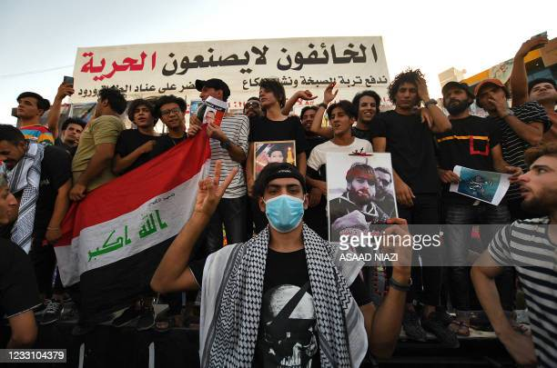 Iraqis demonstrate in the central city of Nassiriyah on May 25 to demand accountability for a recent wave of killings targeting activists. -...